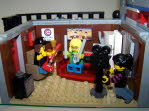 Wayne's World!  Wayne's World!  Party Time!  Excellent!  Behold, Wayne and Garth's North Pole Apartment Studio!  The Apartment Features Wayne's Chair, Garth's Sofa, A Fridge, Camera & Camera Dudette, And Various Pictures On The Wood Panelled Walls!